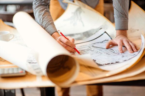 Man fixing a drawing plan